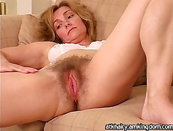 cute mature is getting her hairy cunt rammed on bed