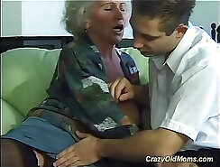 Busty Mom Gets On Her Knees And Sucks Cock