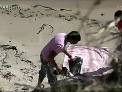 Couple has sex on the beach from outside