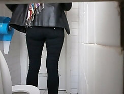 brunette is peeing and using two fingers to reach climax